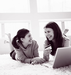 Two girls laughing with laptop