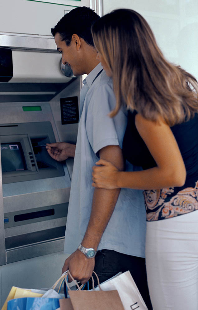 man and woman at atm