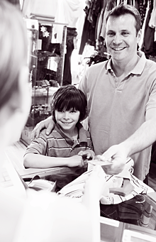 Dad and son making purchase at store