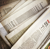 Press Releases - image of newspapers